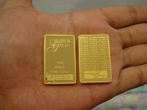 public_gold_bar_atas_tapak_tangan